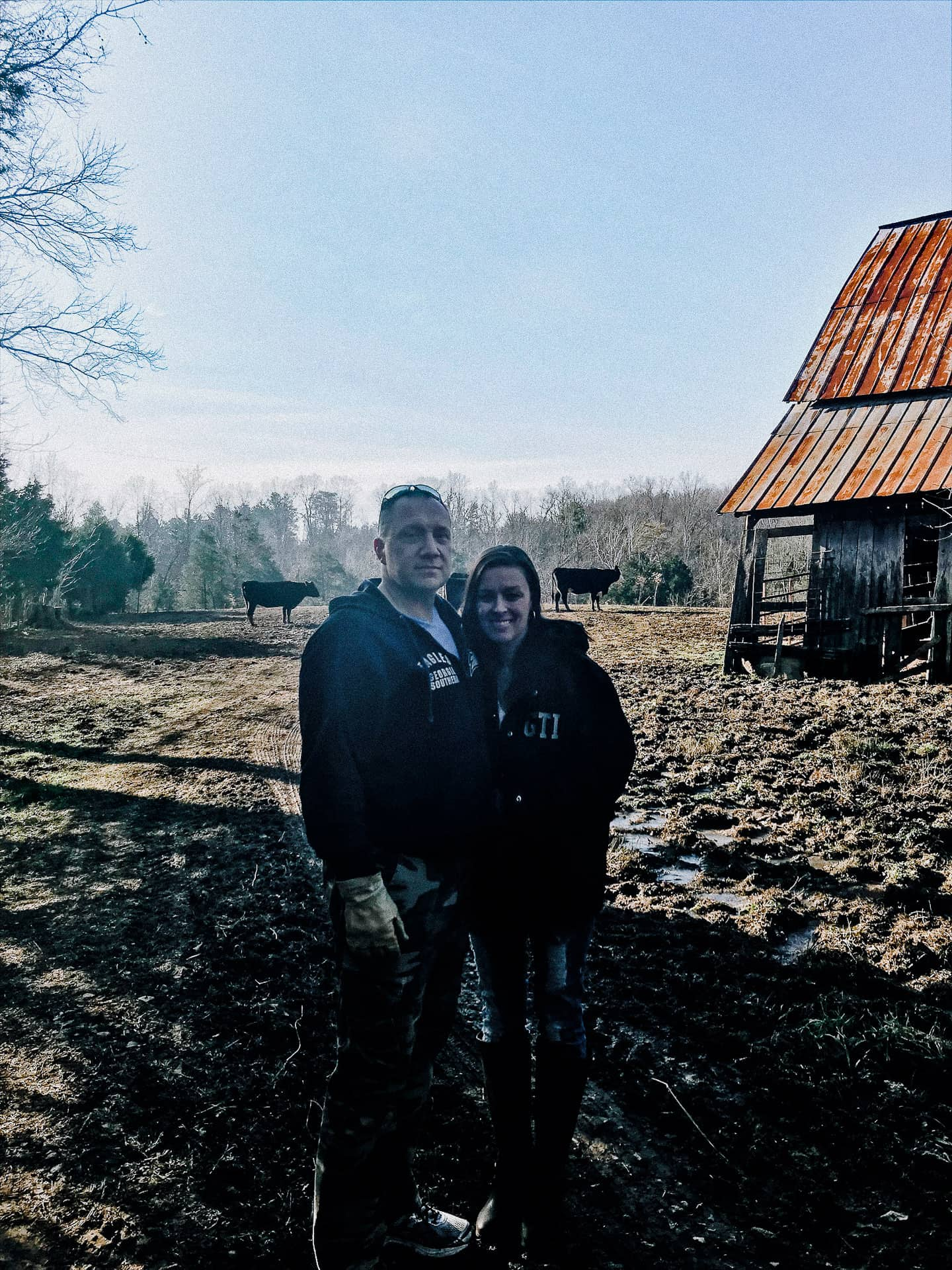 Mike and Amy standing near the barn.