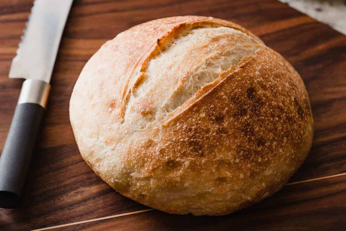 Closeup photo of a fresh loaf of sourdough bread.