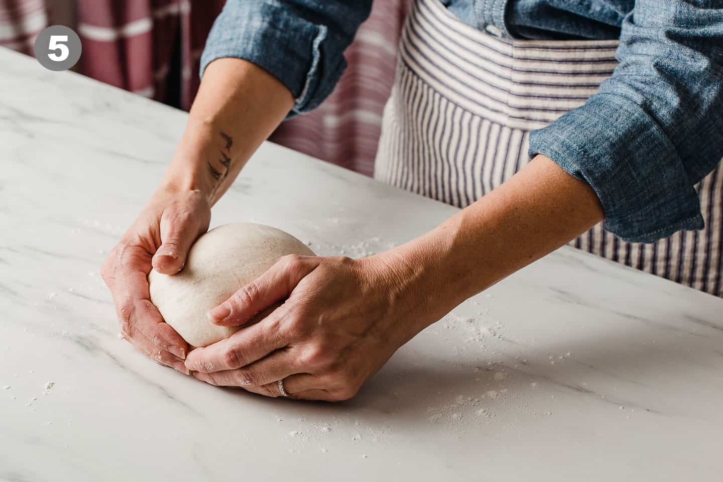 A woman shaping dough.