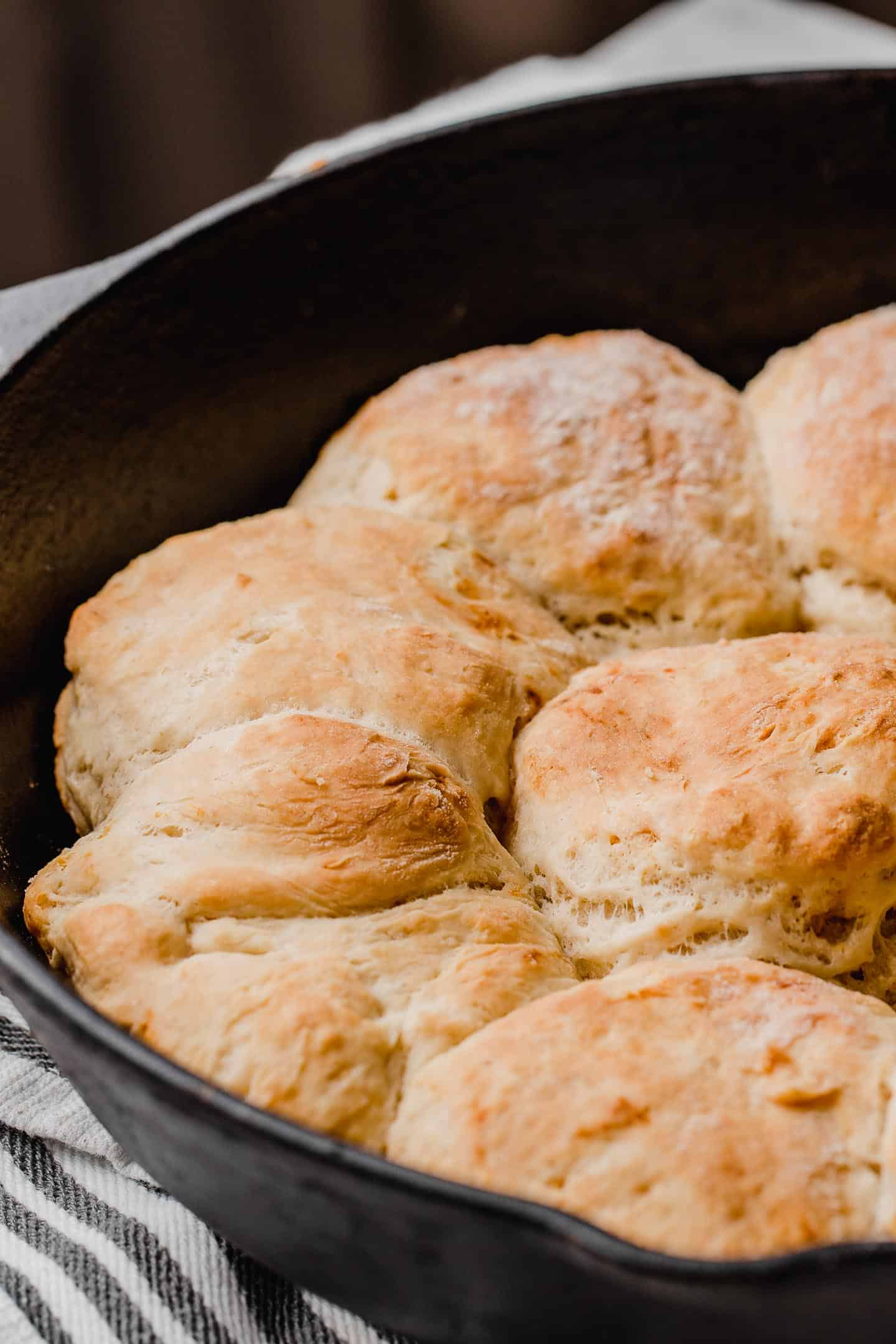 Sourdough biscuits baked in a skillet.