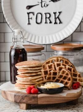 Sourdough pancakes and sourdough waffles on a tray.