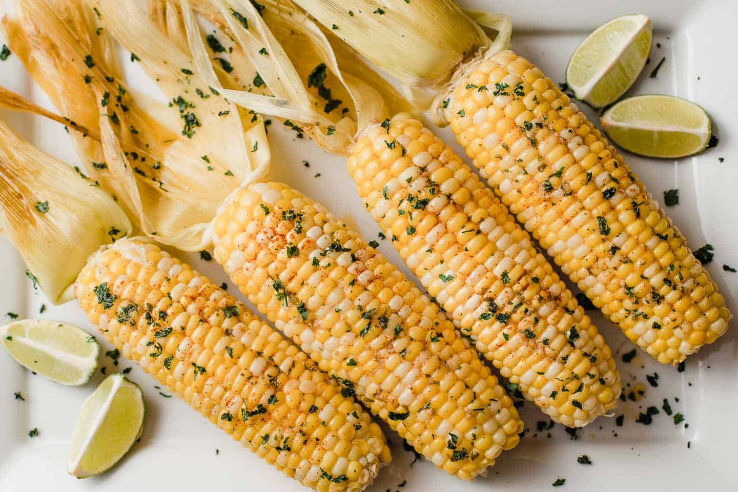 Corn on the cob with melted butter and herbs.
