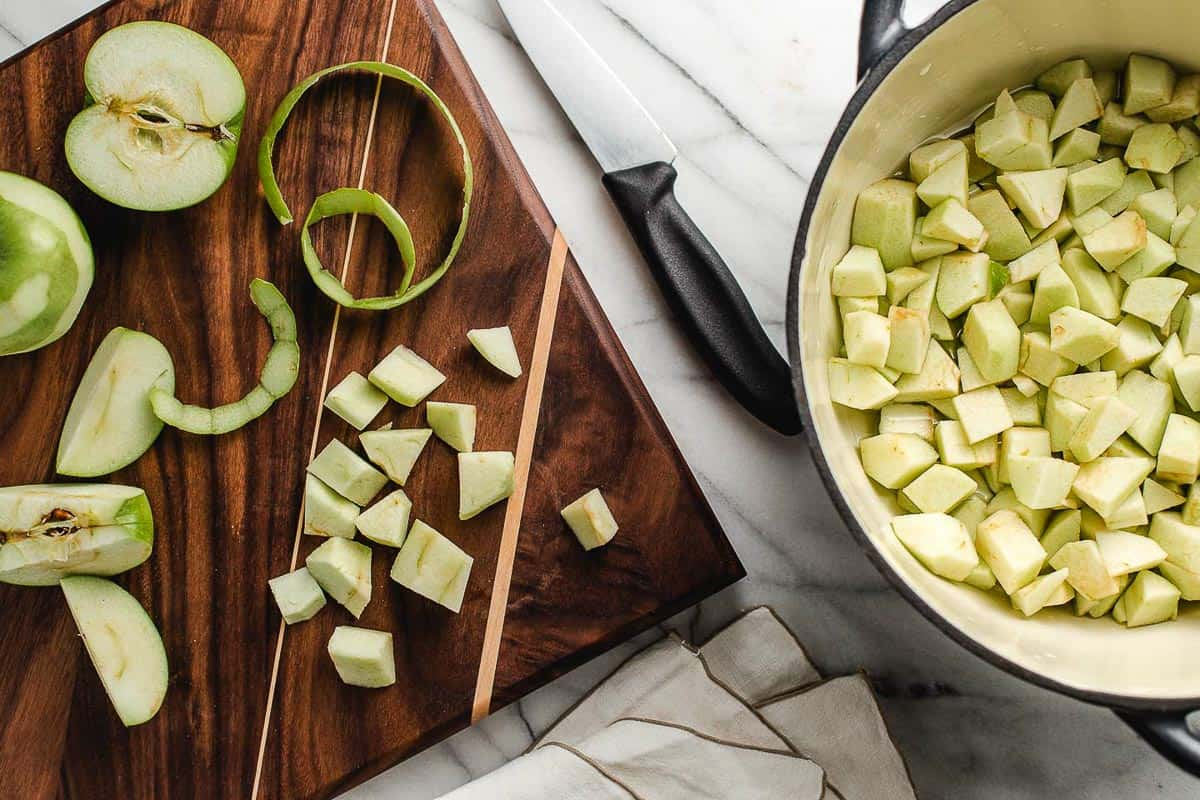 Granny smith apples on a cutting board.