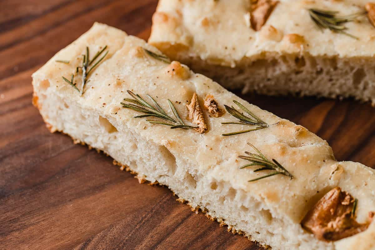 A closeup photo of a slice of sourdough focaccia.