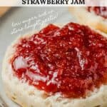 A closeup picture of strawberry jam on a biscuit.