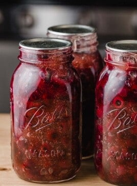 Blueberry pie filling in ball jars.