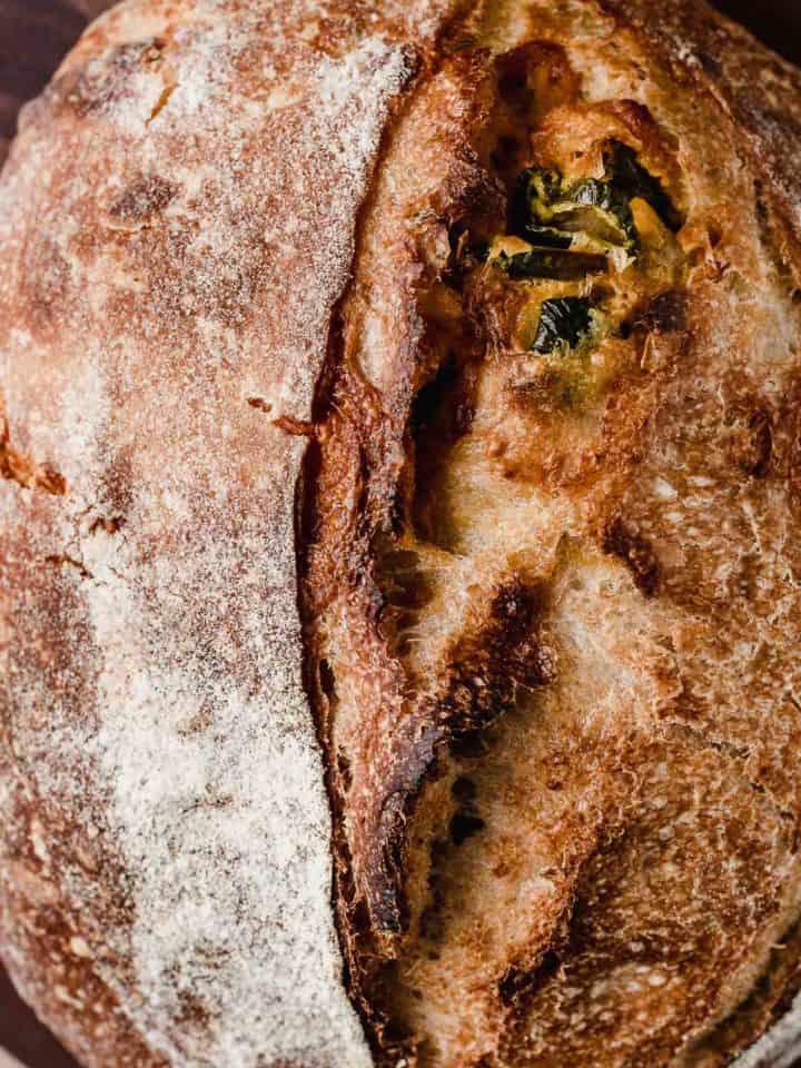 Jalapeno cheddar sourdough bread on a cutting board.