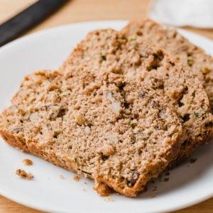 Sourdough zucchini bread slices on a plate.