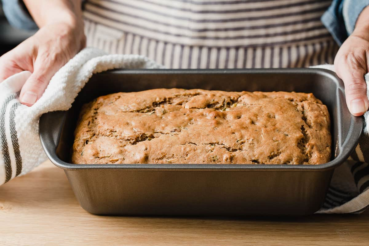 Baked sourdough zucchini bread in a baking dish.