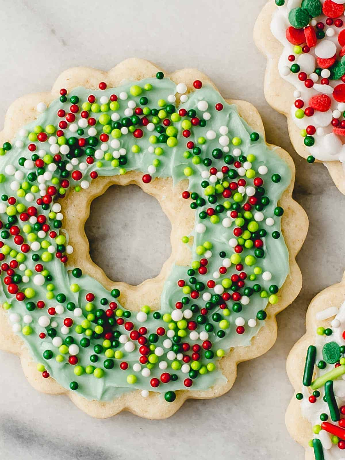 A sourdough sugar cookie in the shape of a christmas wreath.