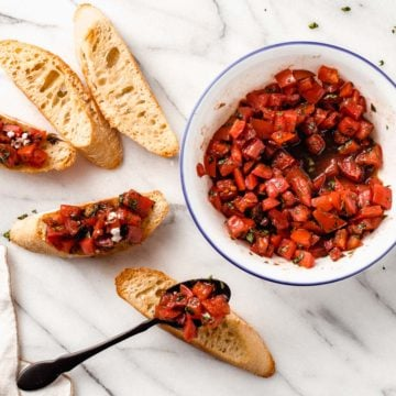 Bruschetta with fresh tomato and basil topping.