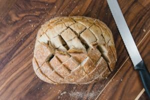 Sourdough bread cut with a grid pattern.