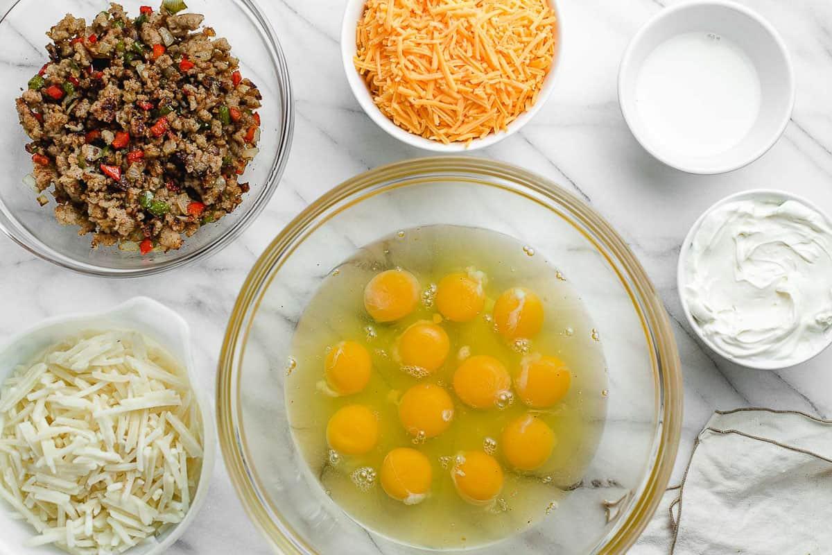 Breakfast casserole ingredients on a table.