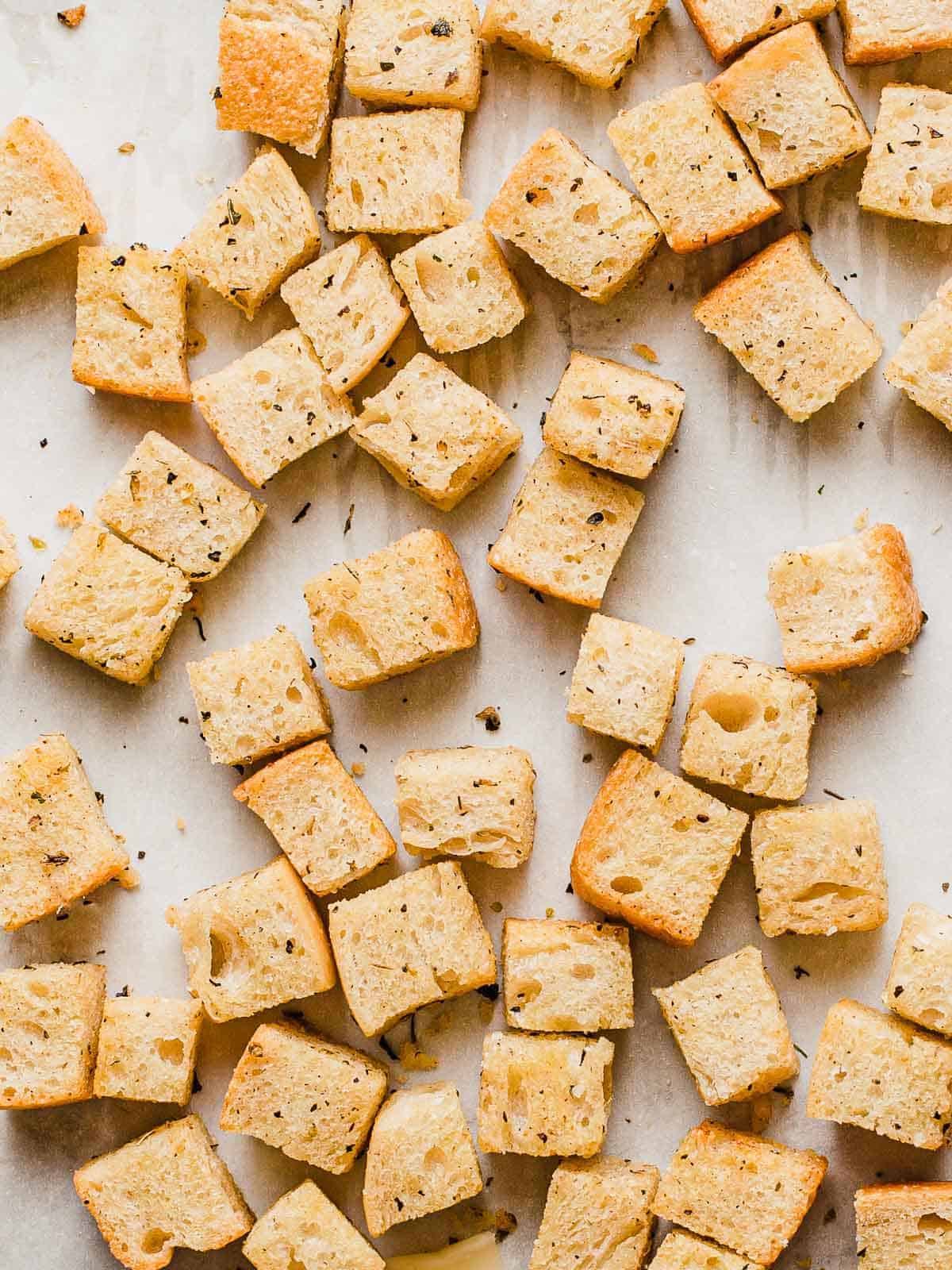 Homemade croutons on parchment paper.