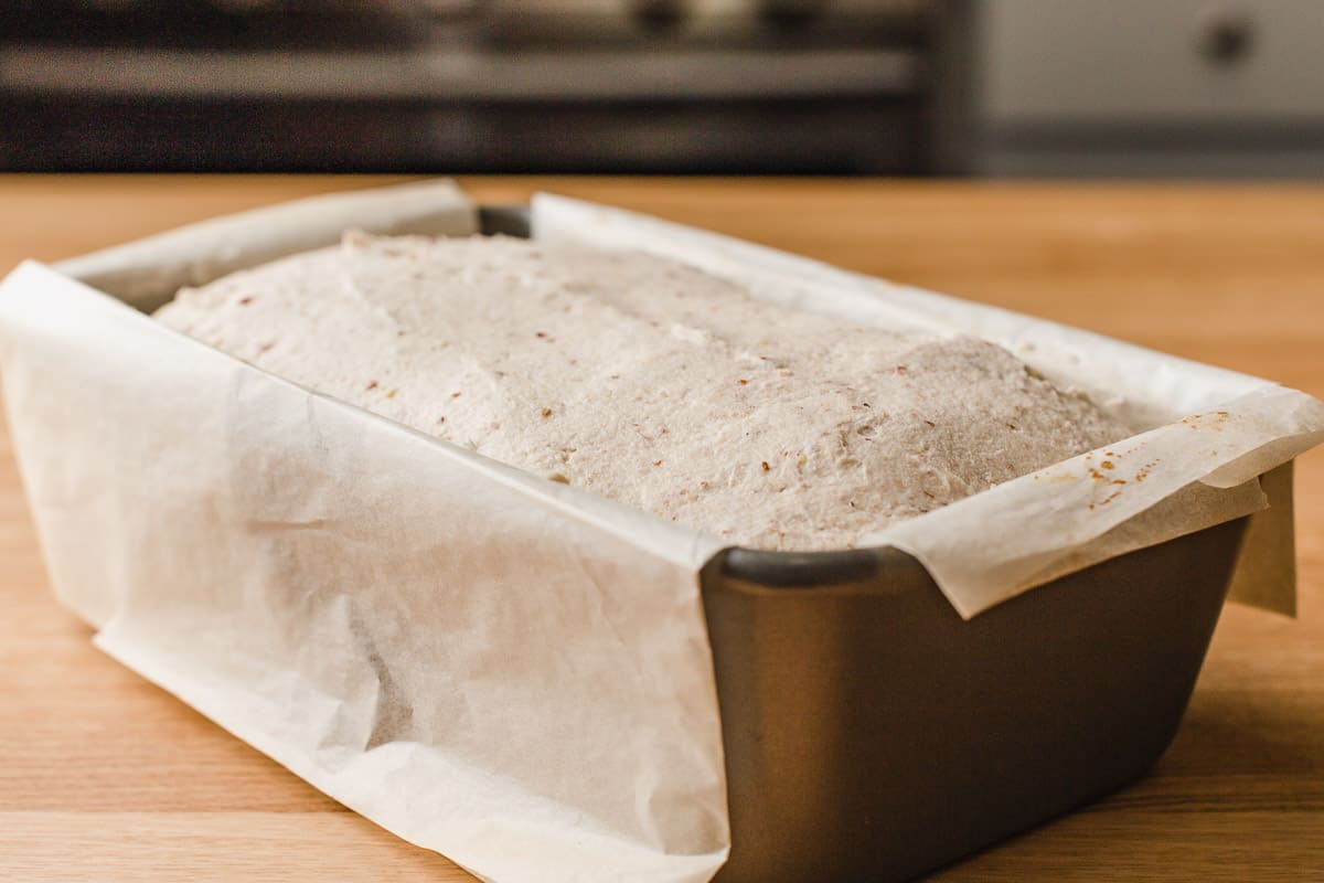 Gluten free sourdough bread rising in a pan.
