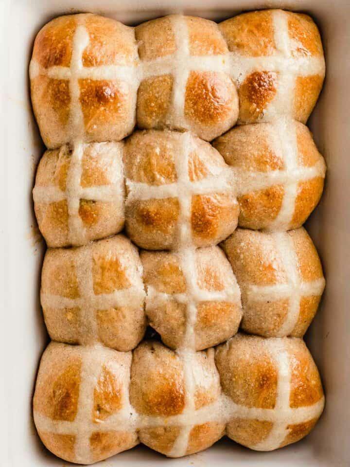 Sourdough hot cross buns in a baking dish.