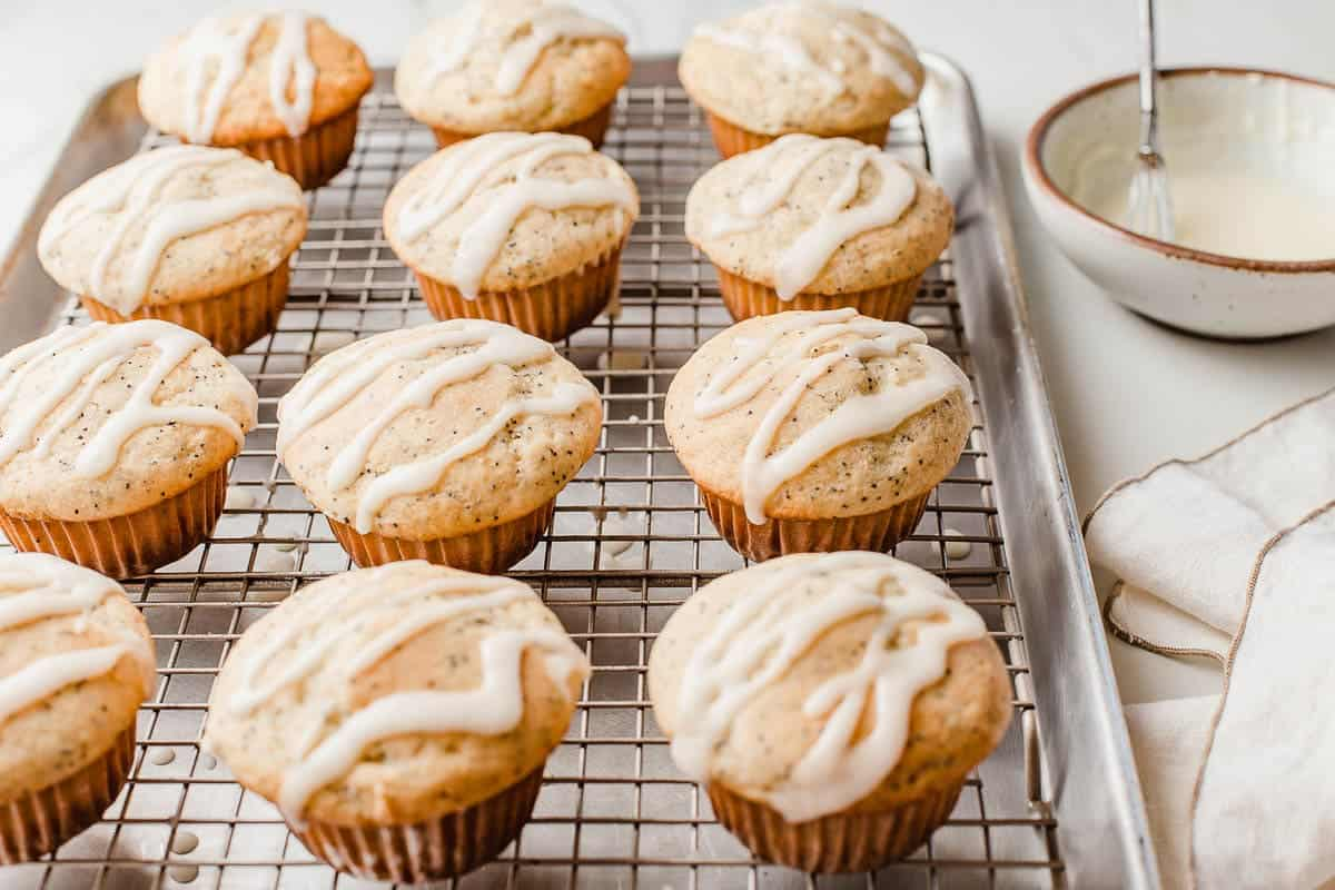 Lemon poppy seed sourdough muffins with glaze.