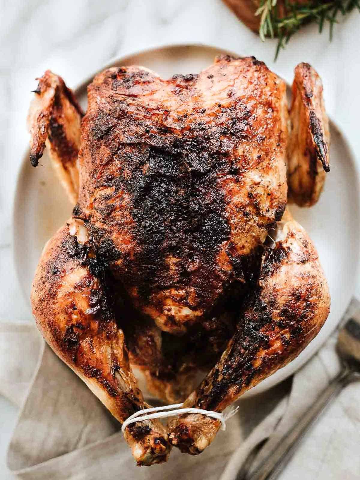 Air fryer whole chicken on platter.