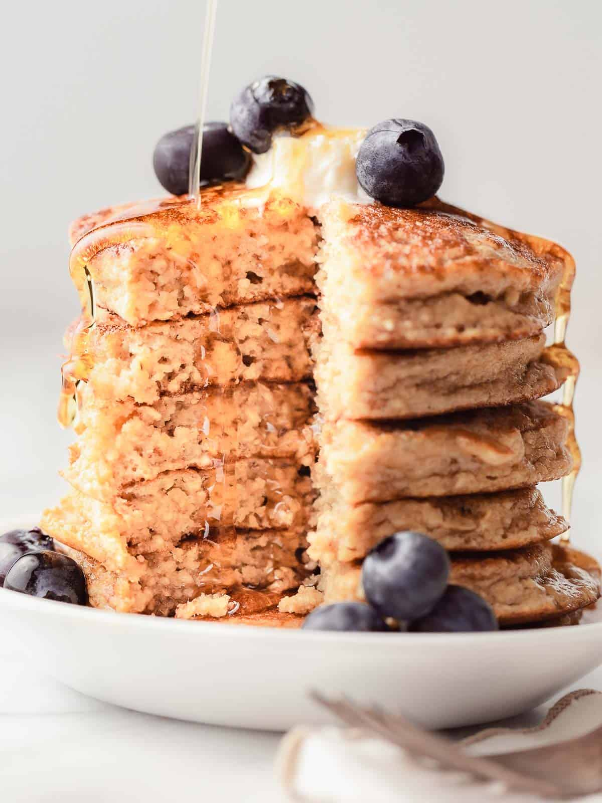 Fluffy protein pancakes with syrup, blueberries and butter.