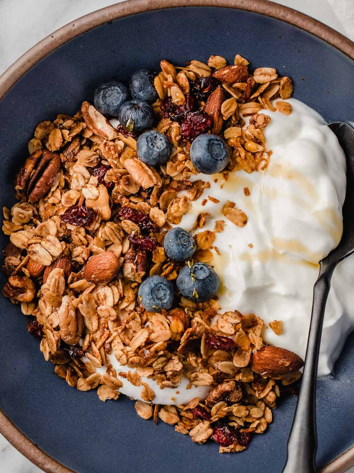 Granola in a bowl with a spoon.