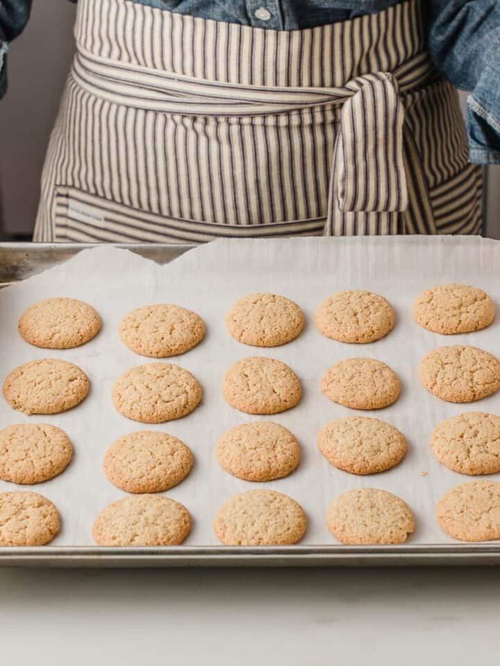 Gluten free homemade nilla wafers on a baking sheet.
