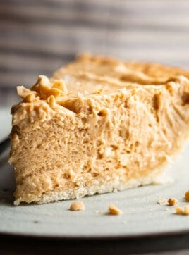 A big slice of peanut butter pie on a plate.
