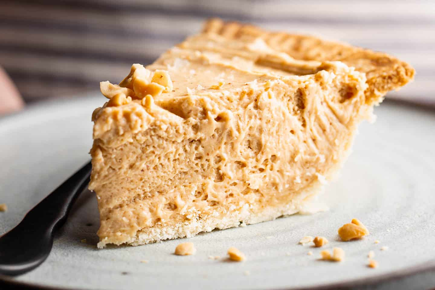 A slice of peanut butter pie on a plate.