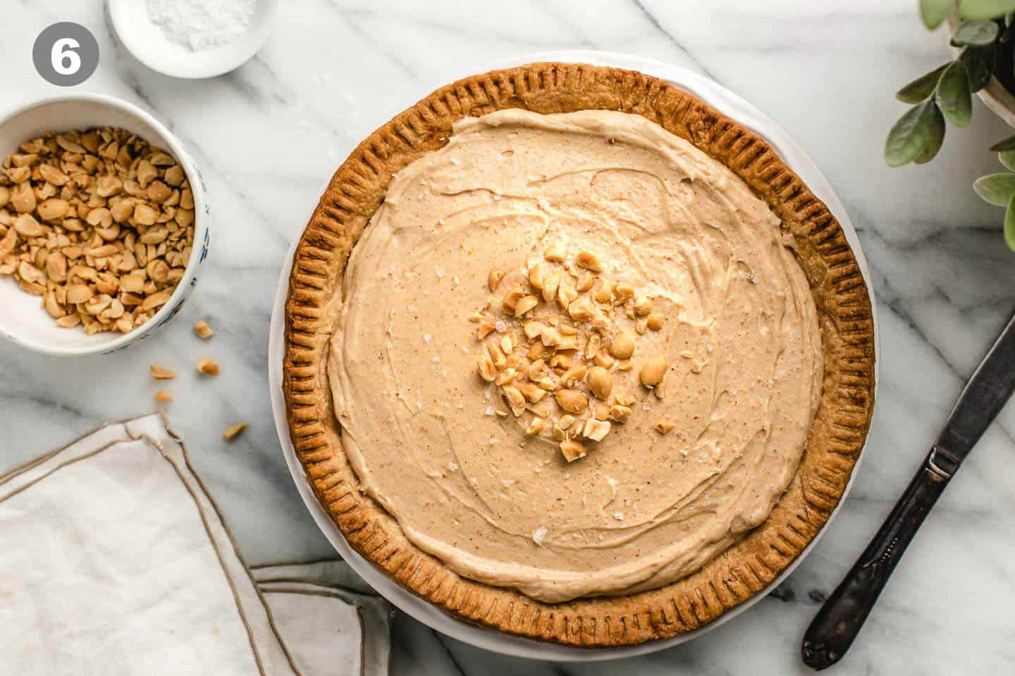 A peanut butter pie with chopped nuts and sea salt.