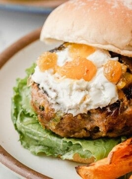 Turkey burger on a bun with mango chutney and goats cheese.