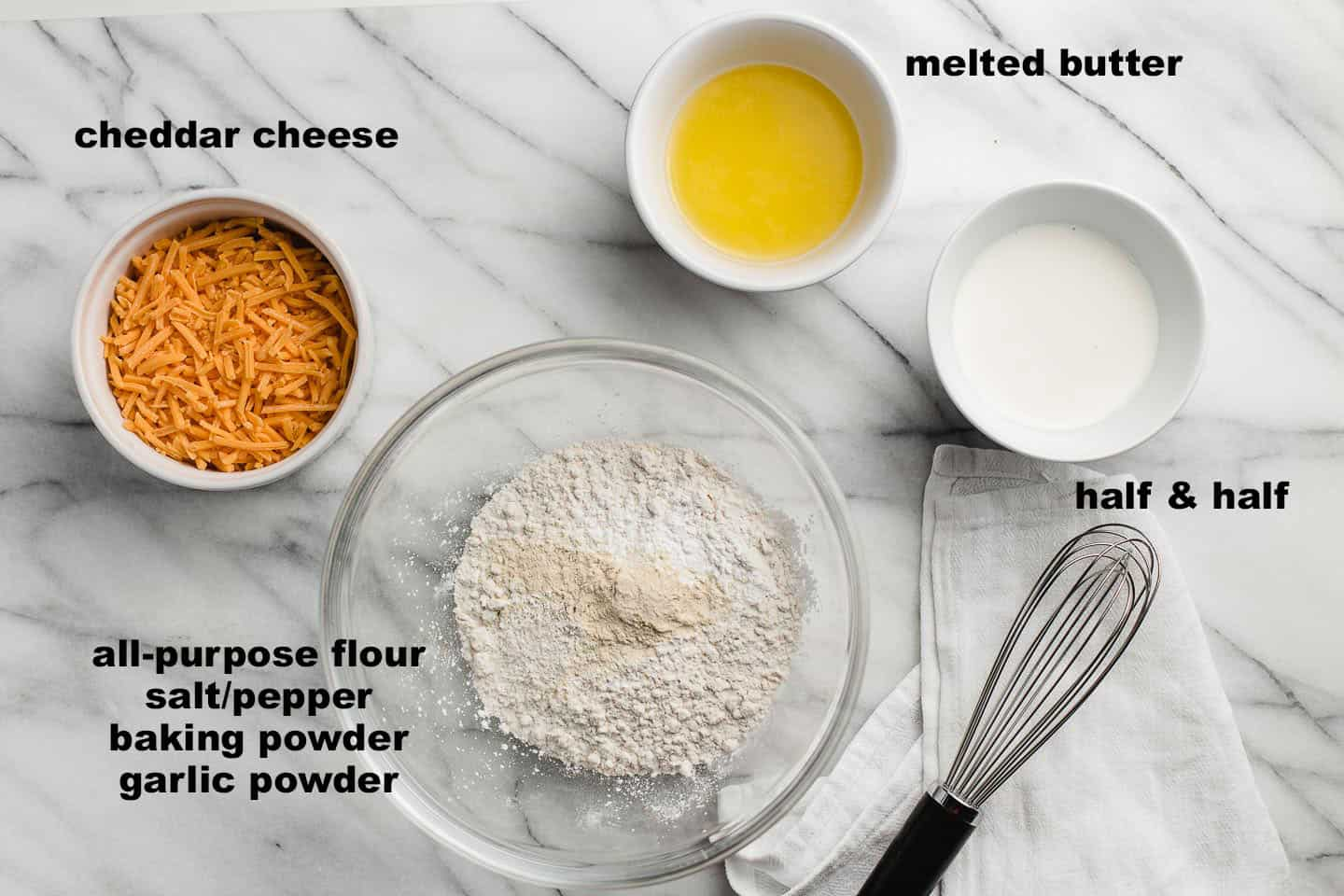Cheddar bay biscuit ingredients on a table.
