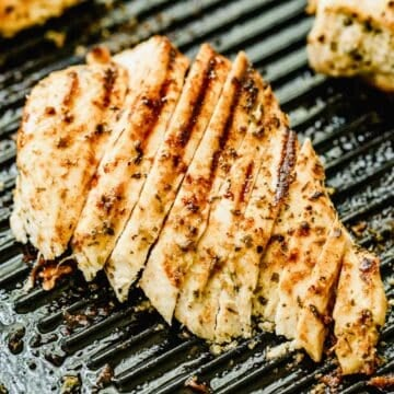 A sliced chicken breast on a grill pan.
