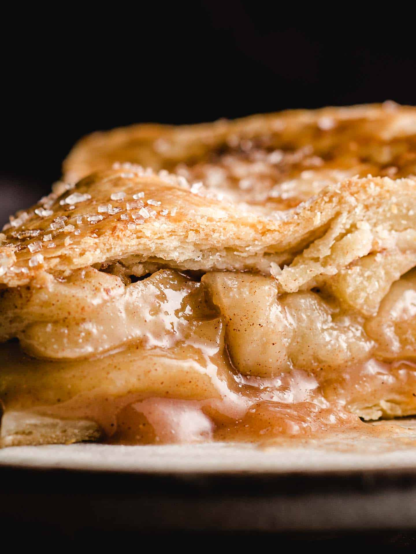 A closeup picture of a slice of apple pie.