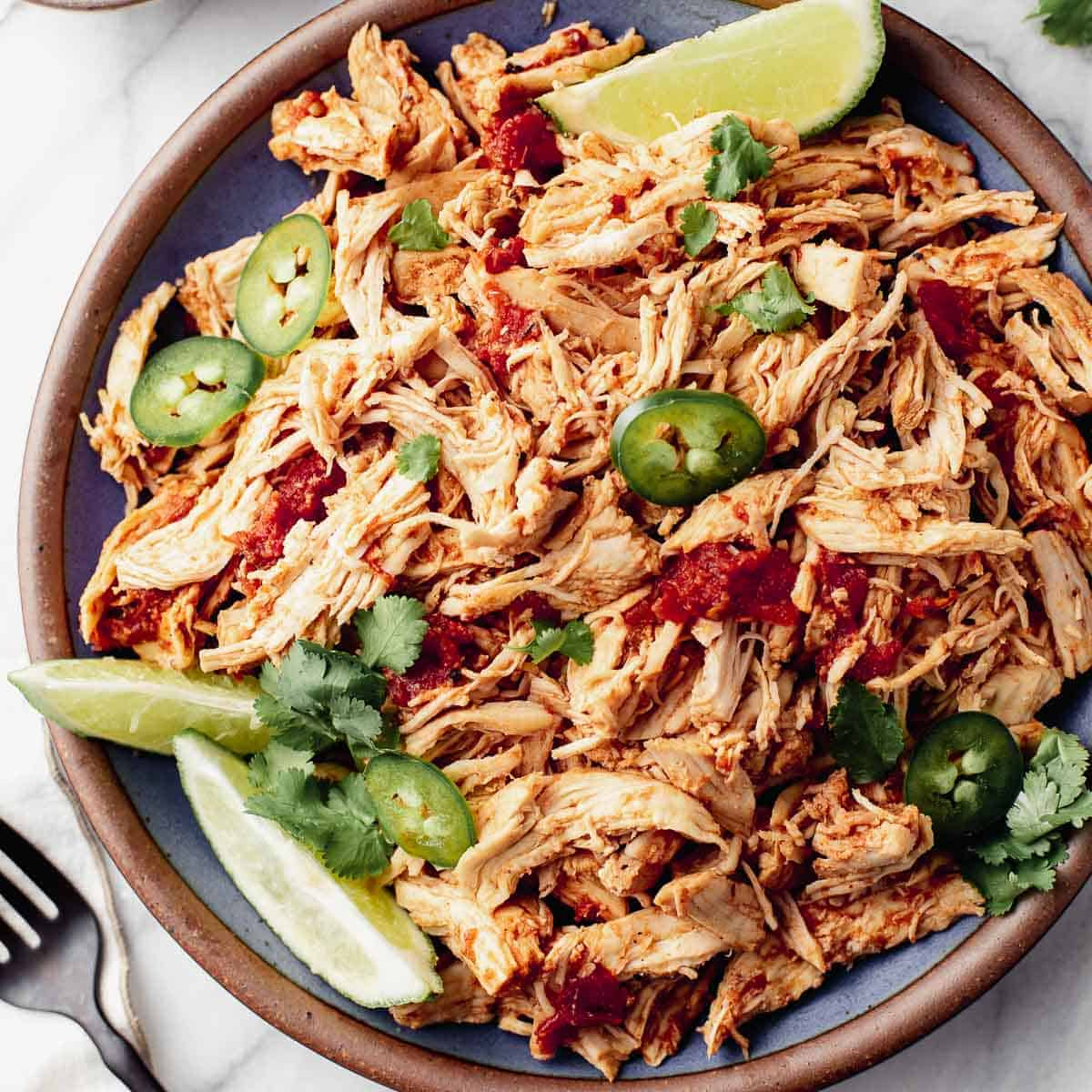 Instant Pot Mexican Shredded Chicken on a serving platter.