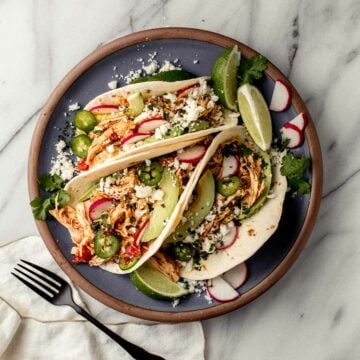 Chicken tacos on a plate.