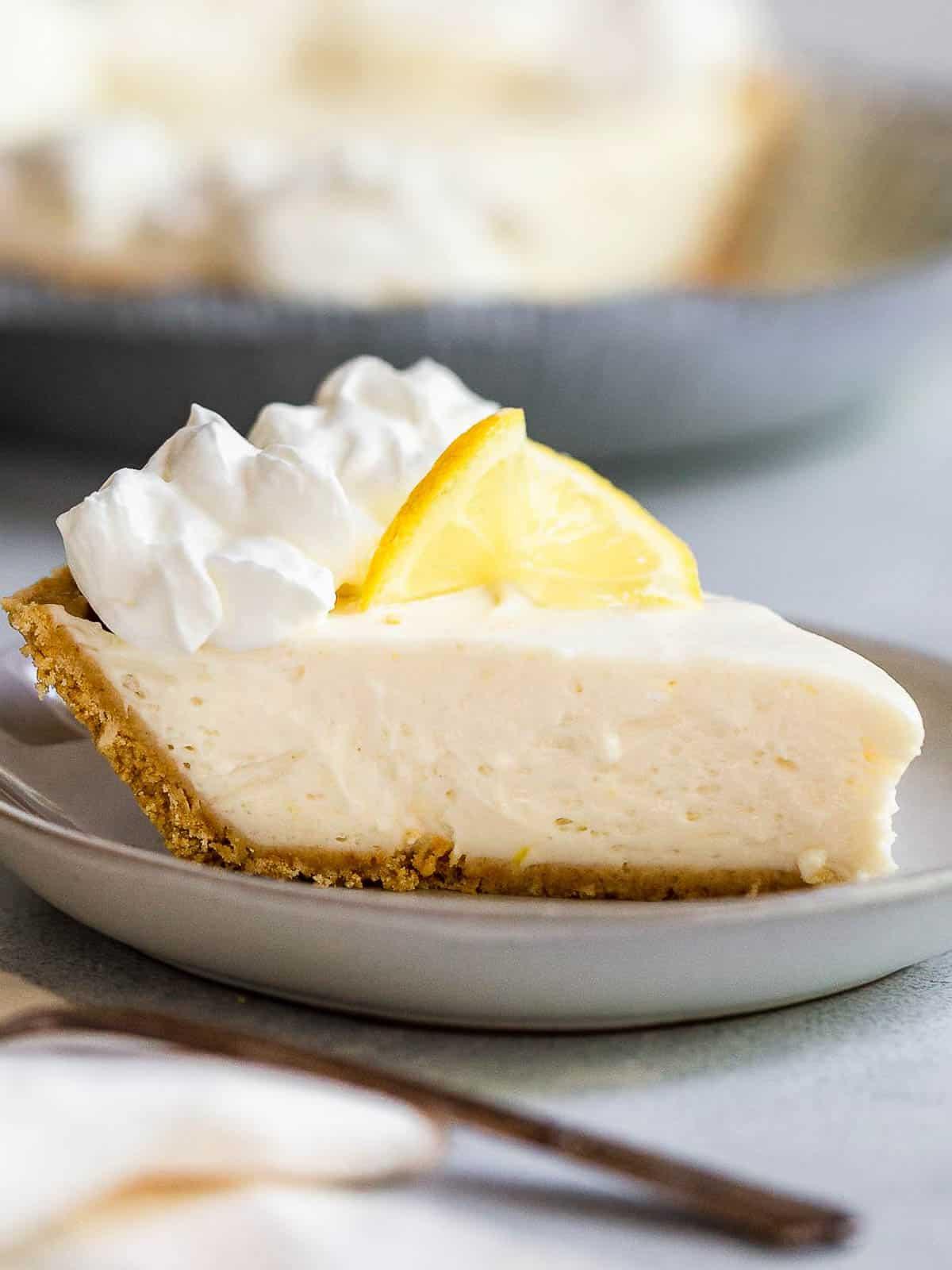 A slice of no-bake lemon icebox pie on a plate.