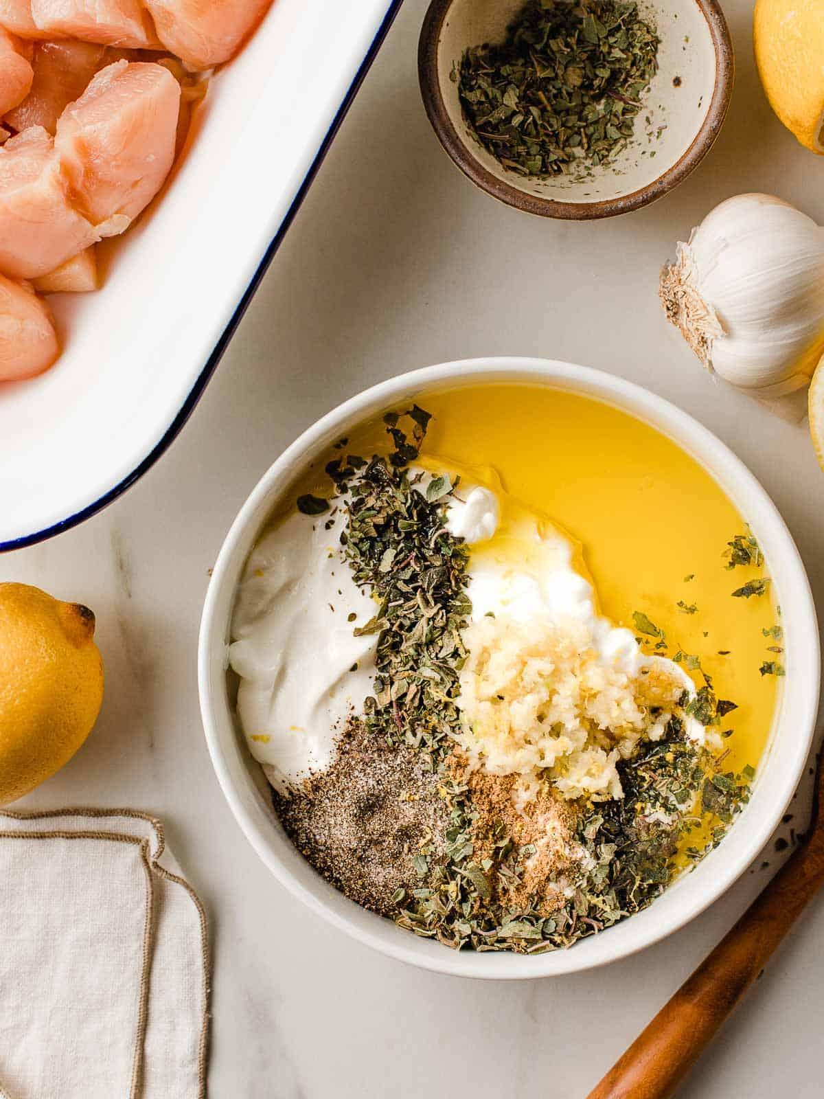 Greek chicken marinade ingredients in a bowl.