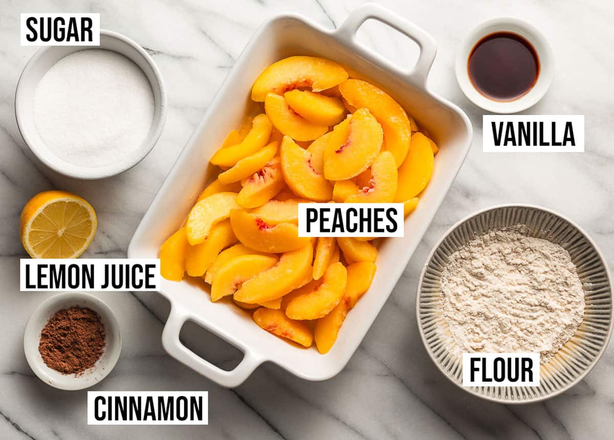 Peach crisp filling ingredients on a table.