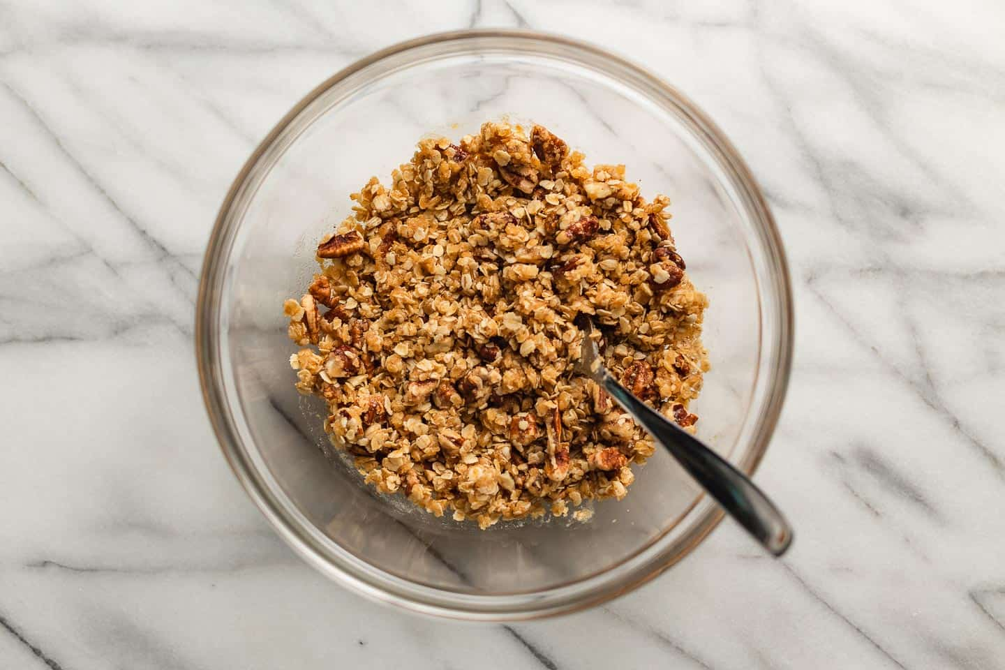 Peach crisp topping mixed in a bowl.