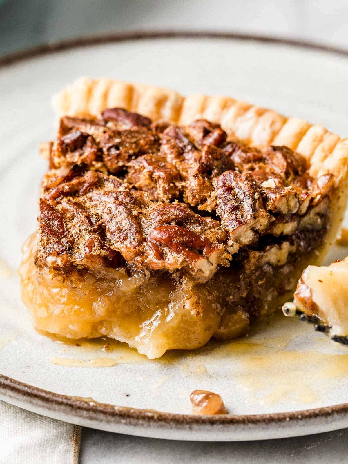 A slice of pecan pie recipe on a plate.