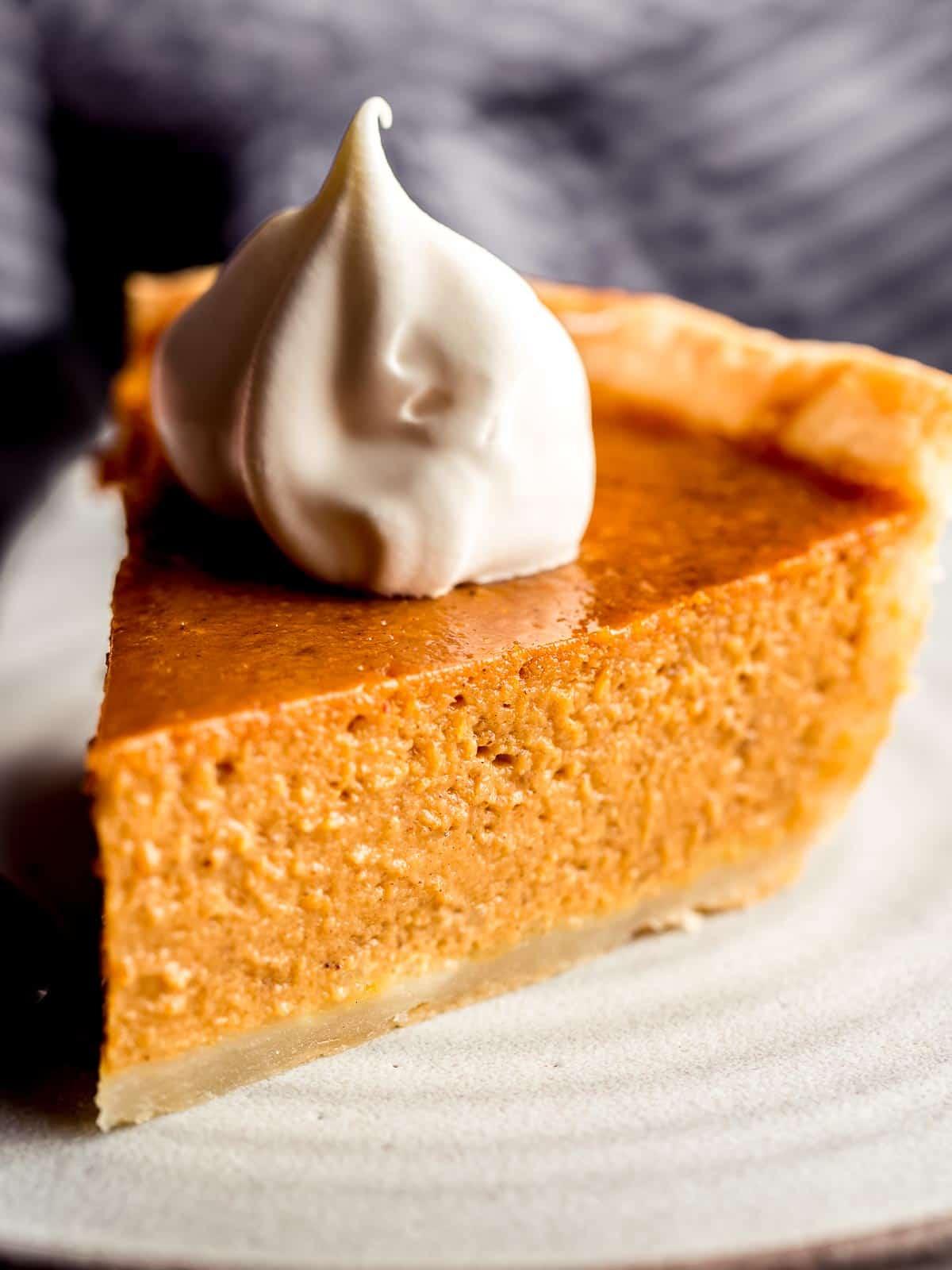 A slice of pumpkin pie recipe on a plate.