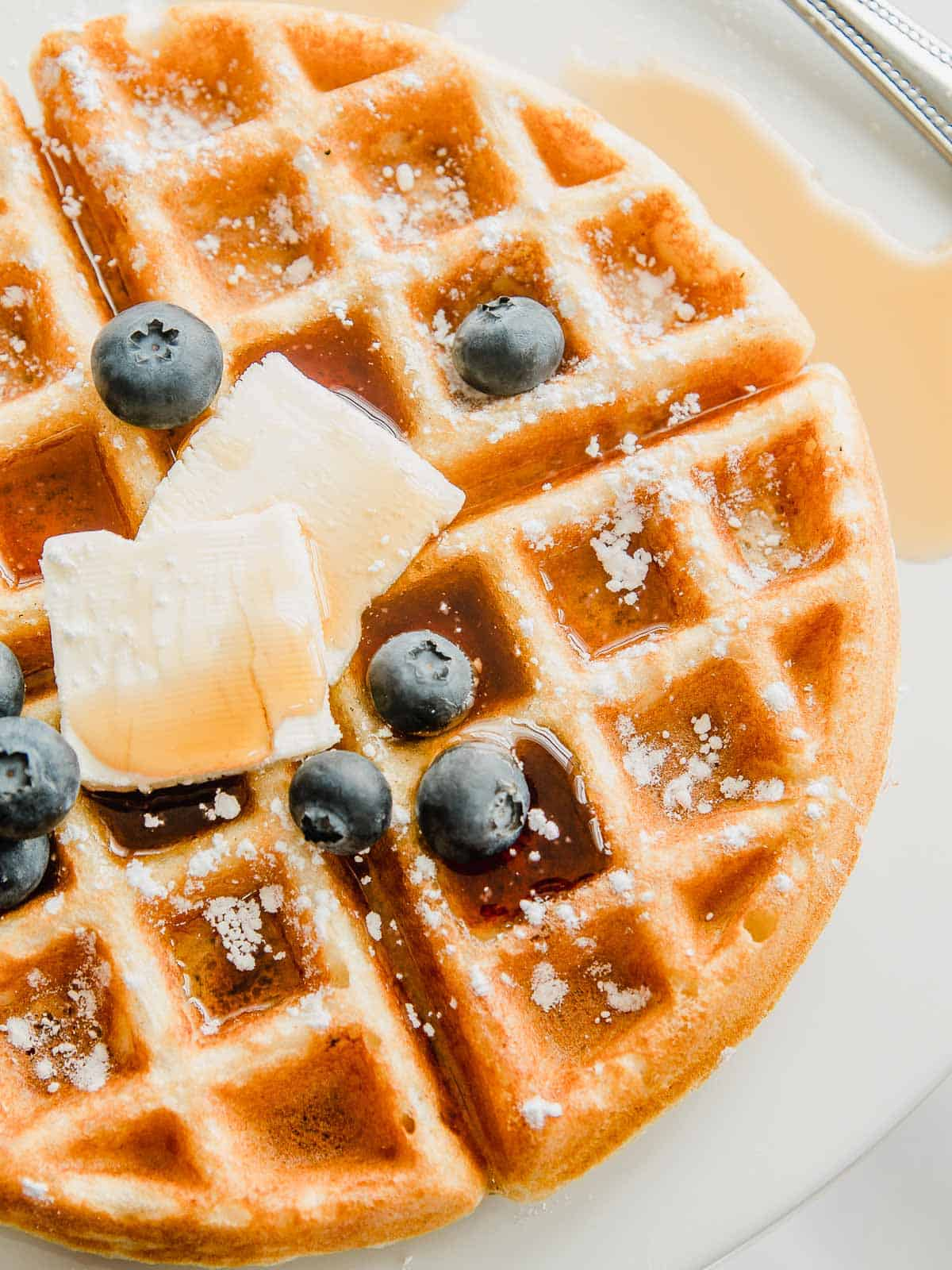 Gluten free waffles with butter and blueberries.