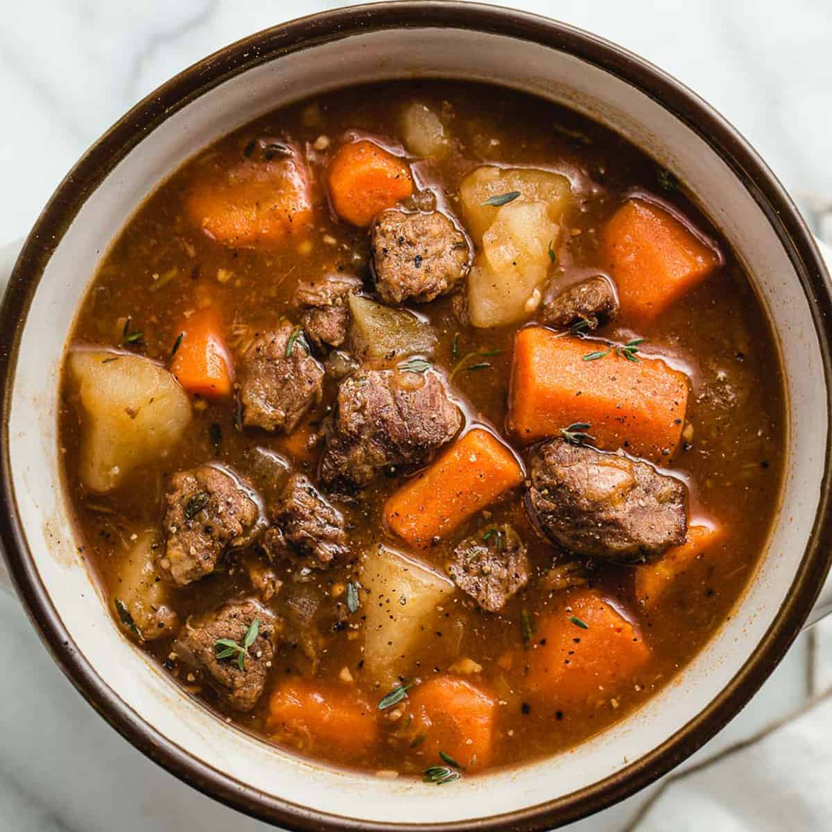 A top view of beef stew in a bowl.