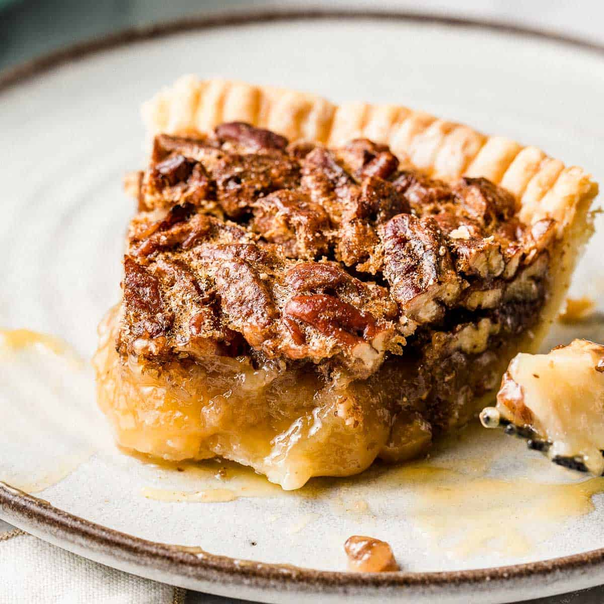 A slice of pecan pie on a plate.