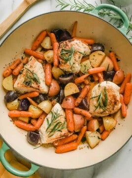 Chicken and vegetables in a dutch oven.