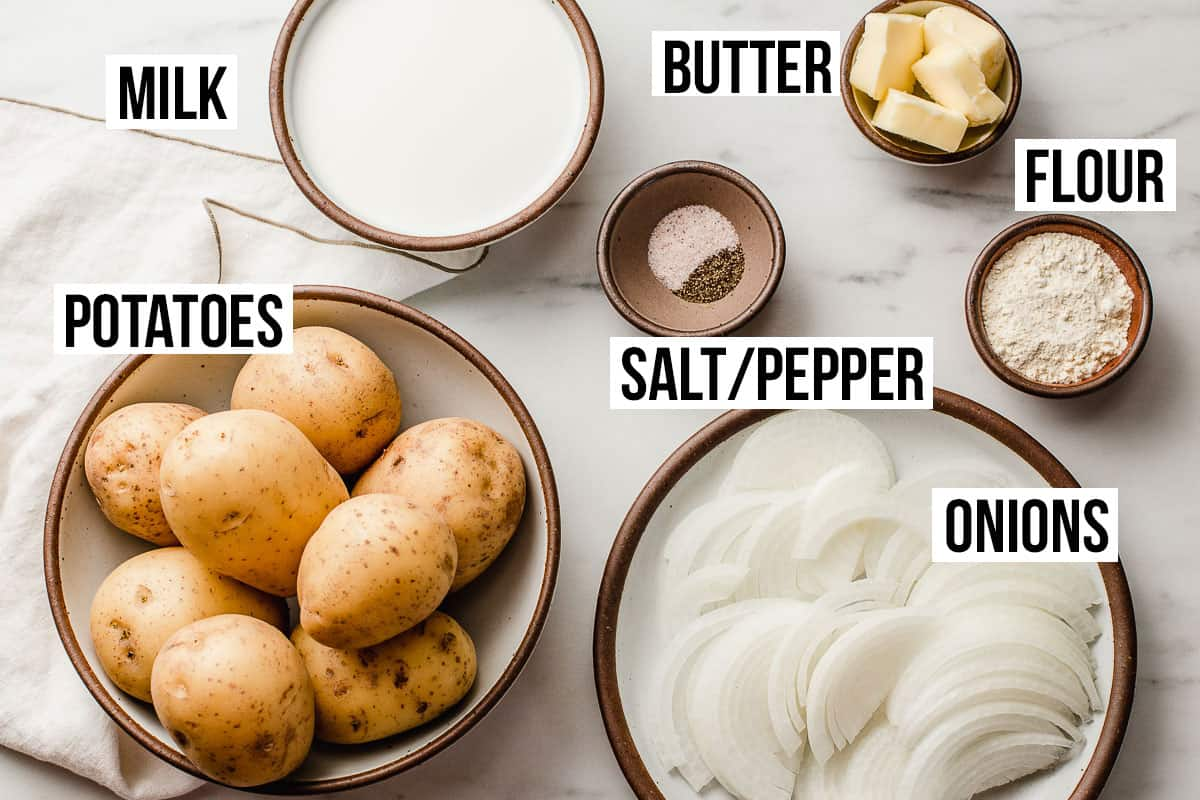 Scalloped potatoes ingredients on a table.