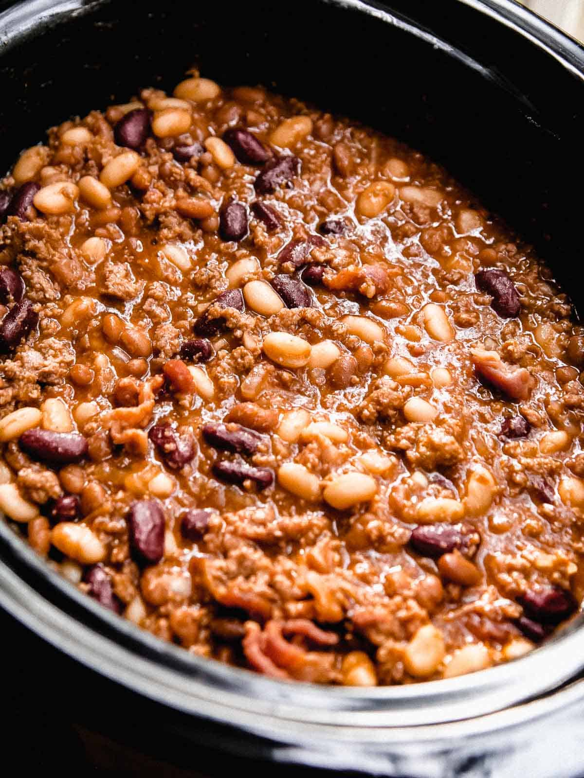 Calico beans in a slow cooker.