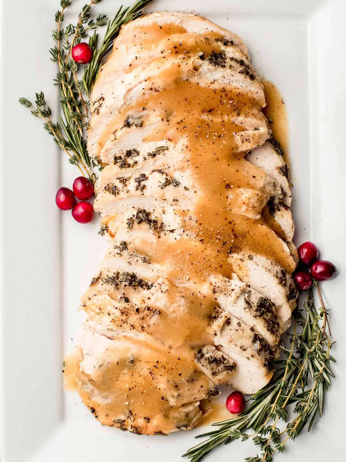 Slow cooker turkey breast on a platter with gravy.