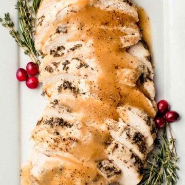 Slow cooker turkey breast on a serving platter.