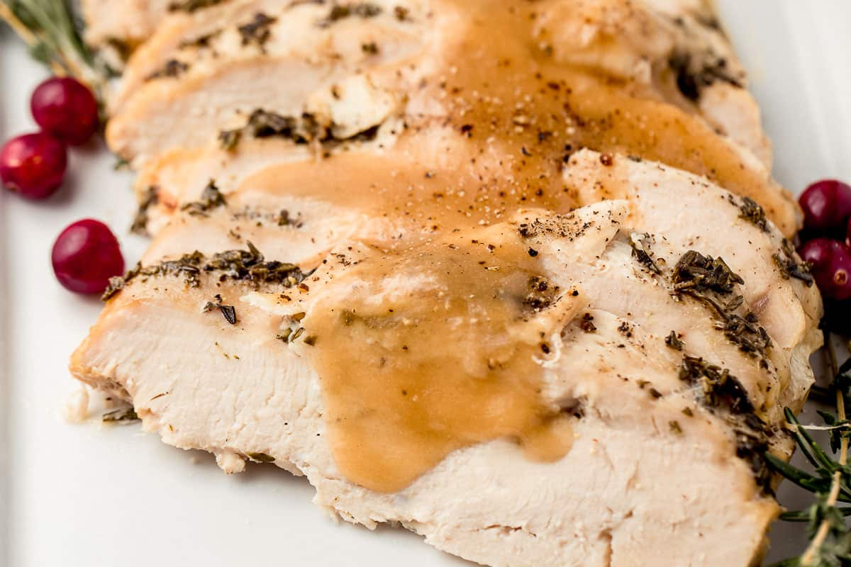 Slow cooker turkey breast side view with gravy.