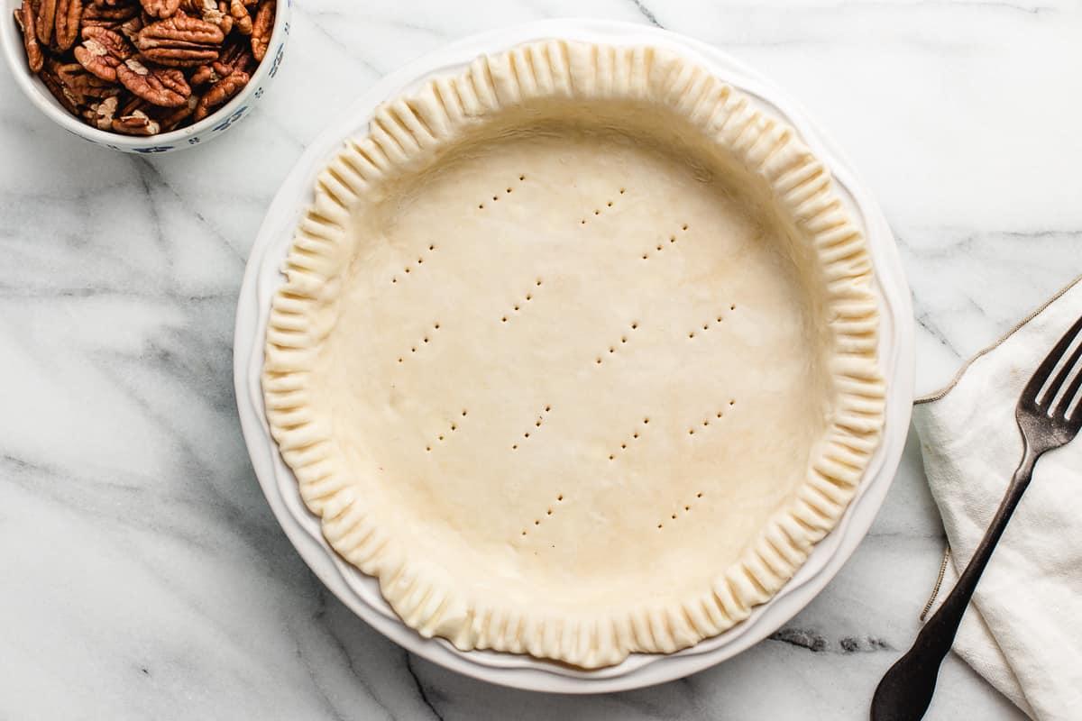 Unbaked pie crust in a pie plate.